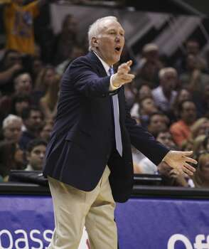 Spurs' Spurs coach Gregg Popovich reacts to a play in the game against the Golden State Warriors in the first half at the AT&T Center on Wednesday, Apr. 2, 2014. Photo: Kin Man Hui, San Antonio Express-News