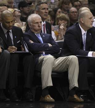Spurs coach Gregg Popovich reacts while watching the game against the Golden State Warriors in the first half at the AT&T Center on Wednesday, Apr. 2, 2014. Photo: Kin Man Hui, San Antonio Express-News