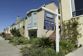 A realtor sign is shown in front of a home for sale in San Francisco, Monday, March 17, 2014. San Francisco will now lend as much as $200,000 to some homebuyers toward a down payment on their first house or condominium. Mayor Ed Lee's decision to double the previous limit of $100,000 was intended to help middle-class residents who have been hit hard by the housing crunch. (AP Photo/Jeff Chiu)