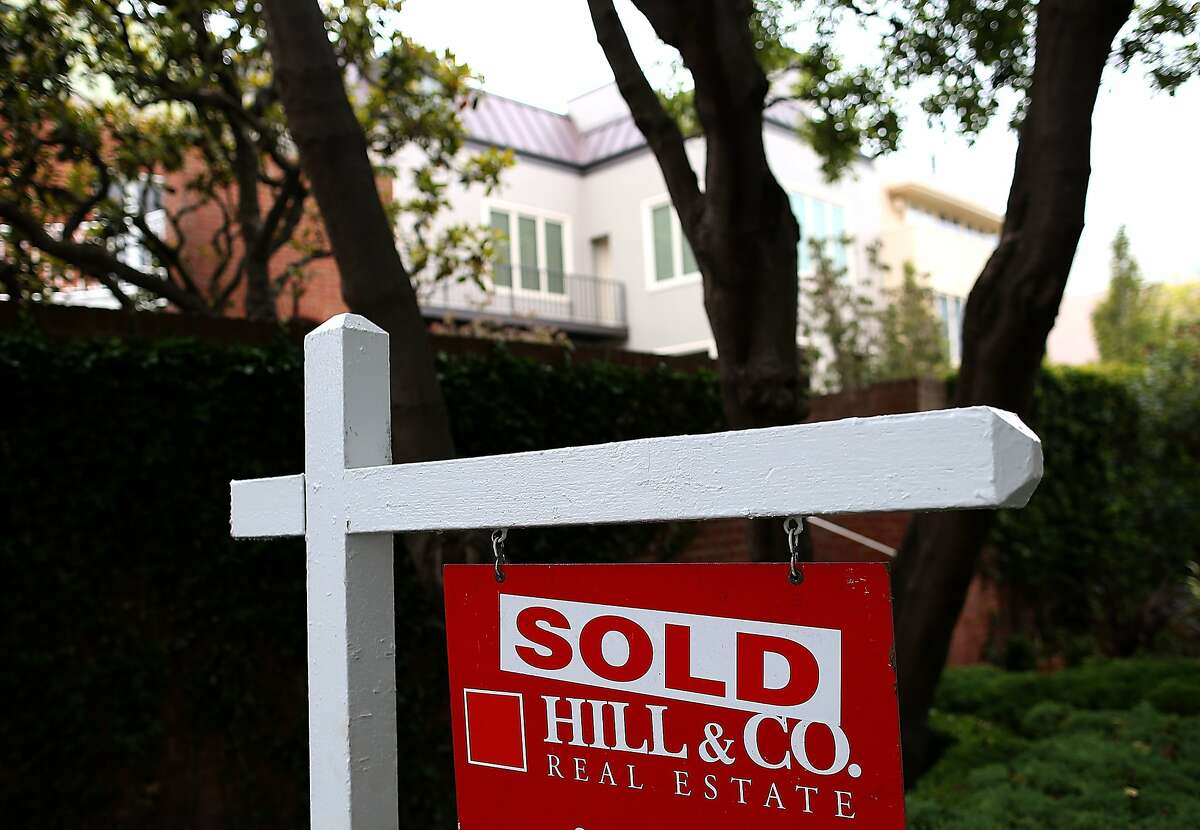 According to reports, US existing home sales fell in January to its lowest level since July 2012. A sold sign is posted in front of a home for sale on July 30, 2013 in San Francisco, California. According to the S&P/Case Shiller composite index survey of 20 metropolitan areas, home prices increased 2.4 percent in May, their highest level since 2006. San Francisco home prices skyrocketed 24.5 percent. (Photo by Justin Sullivan/Getty Images)