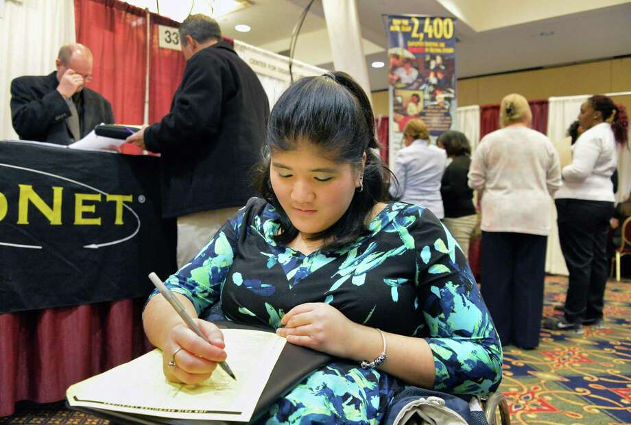 Amanda Ferguson of Malta fills out a job application at the Times Union's spring job fair Wednesday April 16, 2014, at the Albany Marriott in Colonie, NY.  (John Carl D'Annibale / Times Union) Photo: John Carl D'Annibale / 00026508A