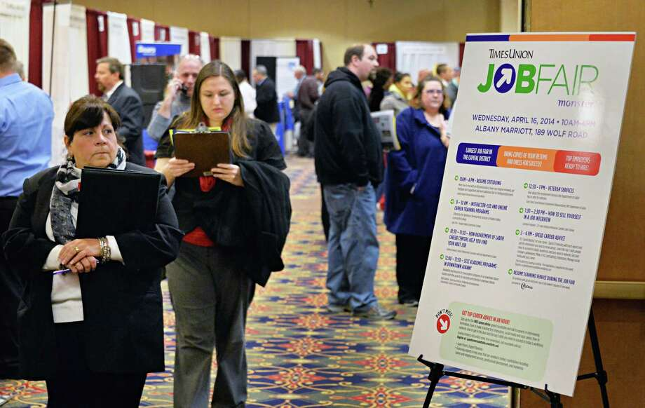 Job hunters and company reps meet at the Times Union's spring job fair Wednesday April 16, 2014, at the Albany Marriott in Colonie, N.Y.  (John Carl D'Annibale / Times Union) Photo: John Carl D'Annibale / 00026508A