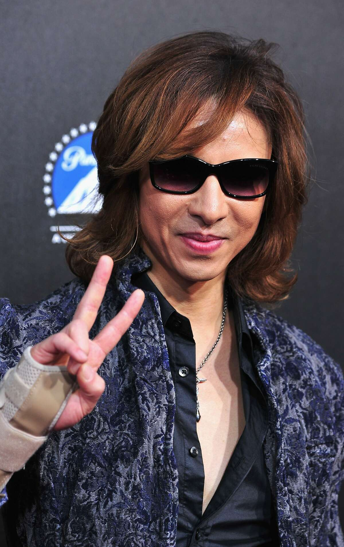 HOLLYWOOD, CA - MARCH 20: Musician Yoshiki arrives at the 2nd Annual Rebels With A Cause Gala at Paramount Studios on March 20, 2014 in Hollywood, California. (Photo by Frazer Harrison/Getty Images)