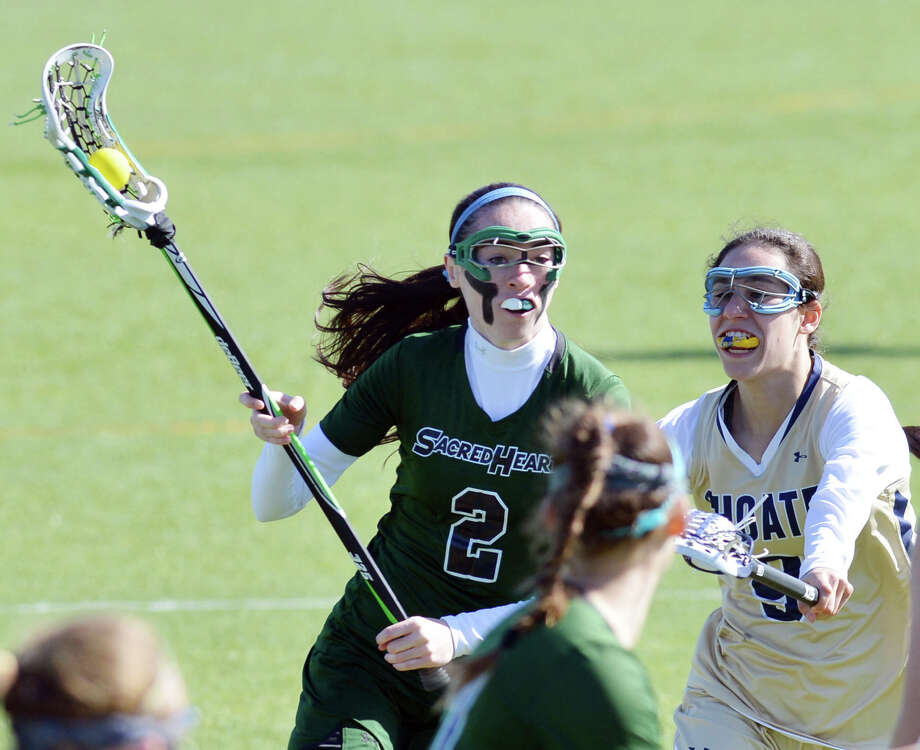 At left, Colleen O'Neill (# 2) of Convent of the Sacred Heart is defended by Choate's Amanda Reisman (#9) during the girls high school lacrosse match between Convent of the Sacred Heart and Choate at Convent in Greenwich, Wednesday, April 16, 2014. Photo: Bob Luckey / Greenwich Time