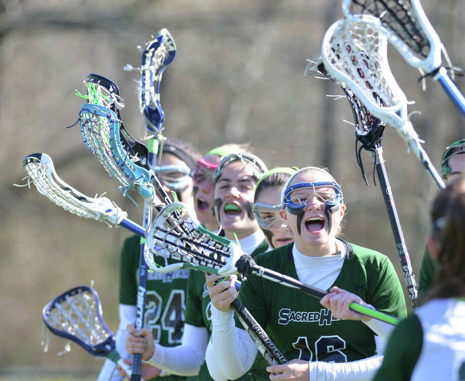 Convent of the Sacred Heart's Fran Hay (#16), at right, cheers during the start of the girls high school lacrosse match between Convent of the Sacred Heart and Choate at Convent in Greenwich, Wednesday, April 16, 2014. Photo: Bob Luckey / Greenwich Time