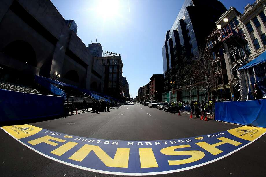The finish line of the Boston Marathon will be bustling with runners and security when the race is run Monday. Photo: Alex Trautwig, Getty Images