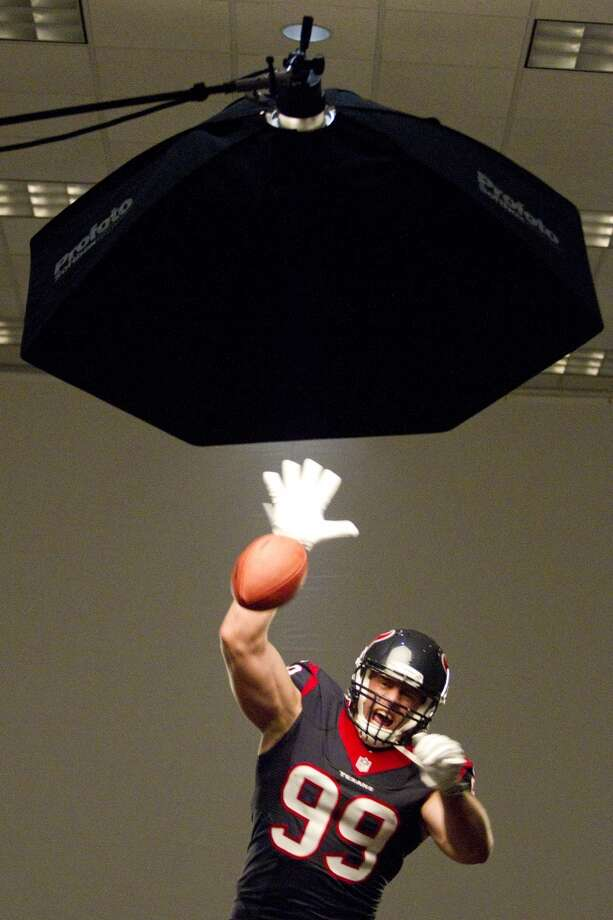 "Texans defensive end J.J. Watt swats a football while shooting photos for the ""We Are Texans"" promotional campaign Photo: Brett Coomer, Houston Chronicle"