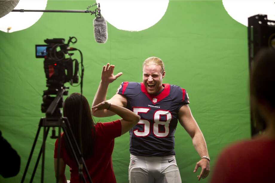 "Texans linebacker Brooks Reed high fives Jackie Maldonado while shooting the ""We Are Texans"" promotional campaign. Photo: Brett Coomer, Houston Chronicle"