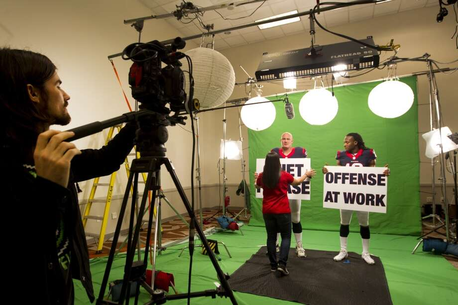 """Texans center Chris Myers and DeAndre Hopkins wide receiver get ready to shoot a segment for the """"We Are Texans"""" promotional campaign Photo: Brett Coomer, Houston Chronicle"""