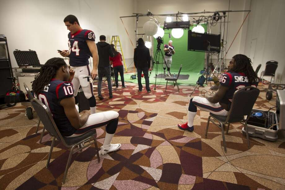 "Texans players DeAndre Hopkins (10), Ryan Griffin (84) and D. J. Swearinger (36) wait for their turn to shoot a segment for the ""We Are Texans"" promotional campaign. Photo: Brett Coomer, Houston Chronicle"