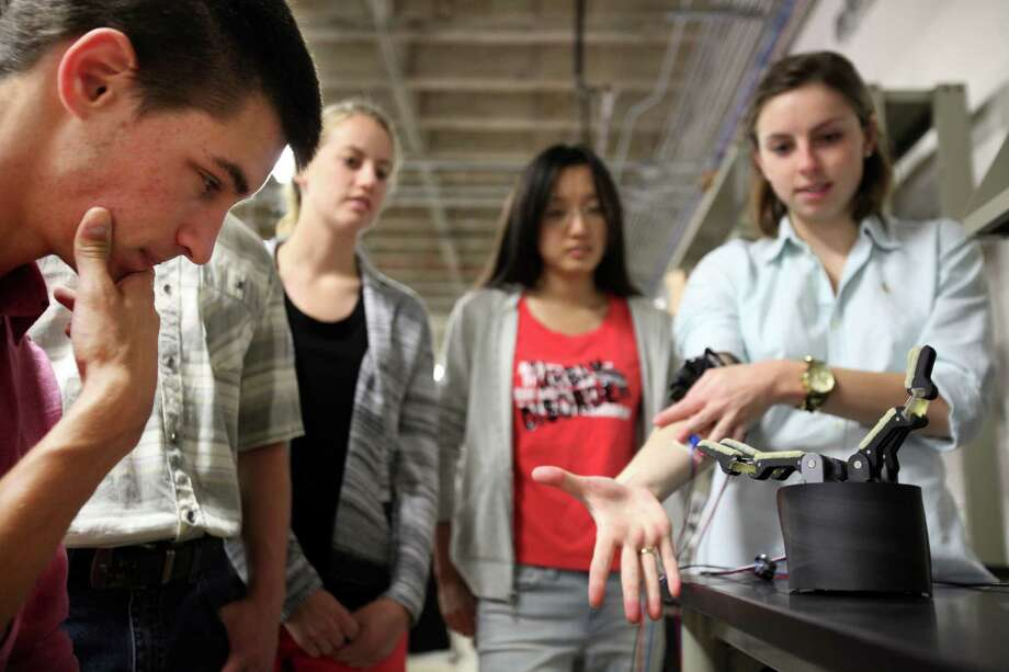 Michael Schubert, 22, a mechanical engineer student, and the rest of Team Magic Touch observe their nearly finished projects at the Oshman Engineering Design Kitchen at Rice University on April 14, 2014, in Houston, Tx. Photo: Mayra Beltran, Houston Chronicle / © 2014 Houston Chronicle