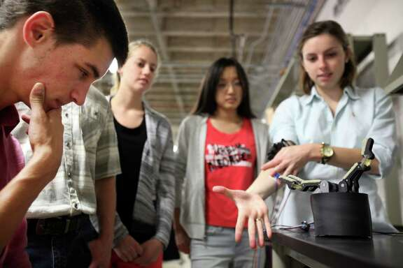 Michael Schubert, 22, a mechanical engineer student, and the rest of Team Magic Touch observe their nearly finished projects at the Oshman Engineering Design Kitchen at Rice University on April 14, 2014, in Houston, Tx.