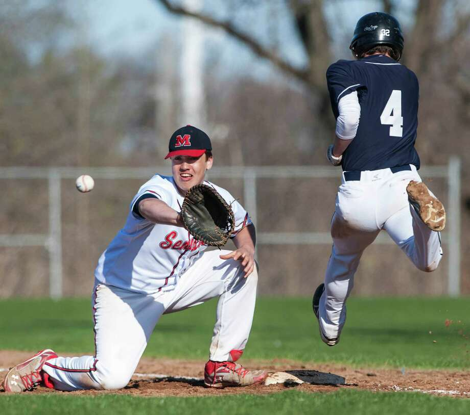Staples high school's Nathan Panzer is called out at first on a close play during a boy's baseball game against Brien McMahon high school played at Brien McMahon high school, Norwalk, CT on Wednesday, April, 16th, 2014. Photo: Mark Conrad / Connecticut Post Freelance