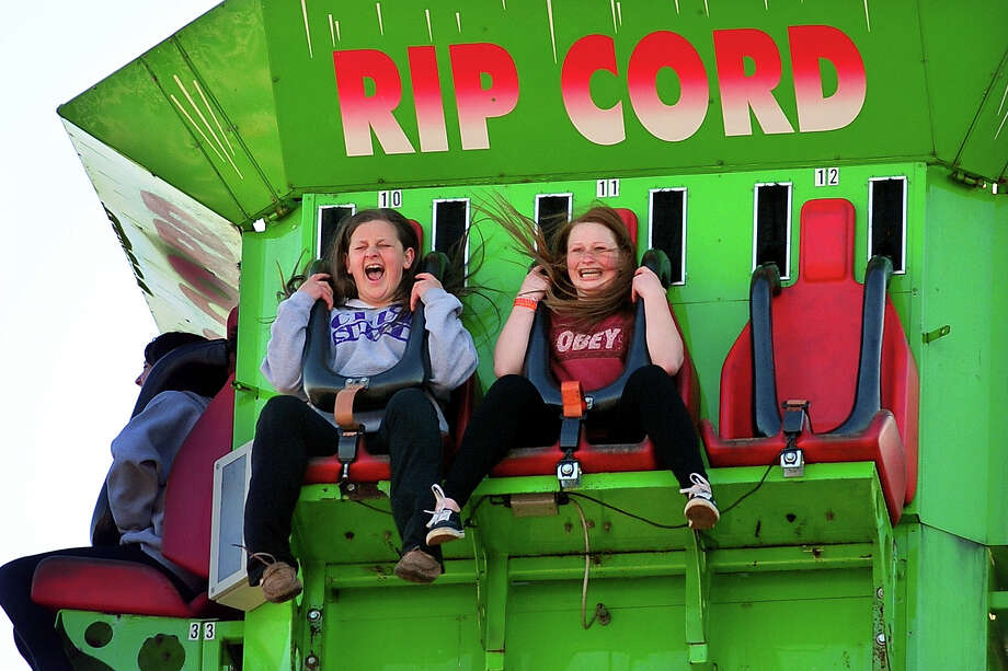 Jessie Velez, 13, at left, and her freind Audrey Crowe, 13, enjoy the free fall on the Rip Cord ride, during the annual Trumbull Rotary Carnival at Hillcrest Middle School in Trumbull, Conn. on Wednesday April 16, 2014. Photo: Christian Abraham / Connecticut Post