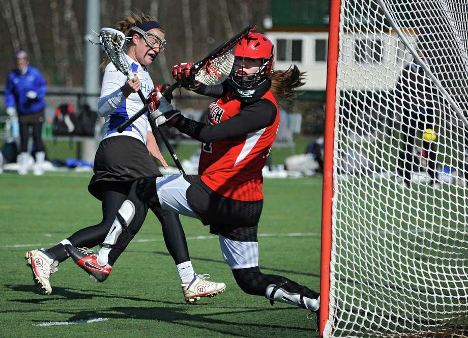 Shaker's Sarah Cheney gets the ball past Guilderland goalie Kaitlyn Hess to score during a lacrosse game at Siena College on Wednesday, April 16, 2014 in Loudonville, N.Y. (Lori Van Buren / Times Union) Photo: Lori Van Buren / 00026482A