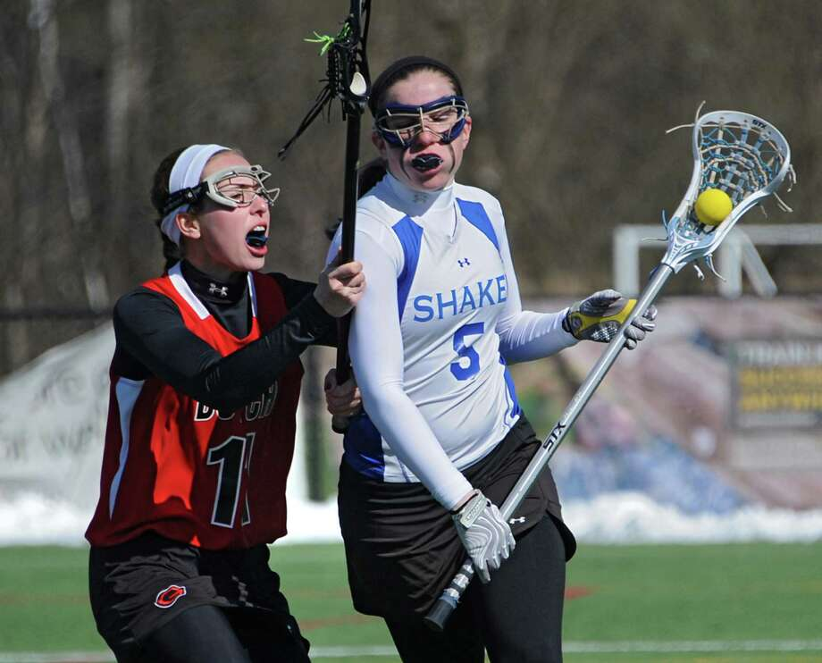 Guilderland's Michelle Burmistrova, left, defends Shaker's Kailyn Hart during a lacrosse game at Siena College on Wednesday, April 16, 2014 in Loudonville, N.Y. (Lori Van Buren / Times Union) Photo: Lori Van Buren / 00026482A