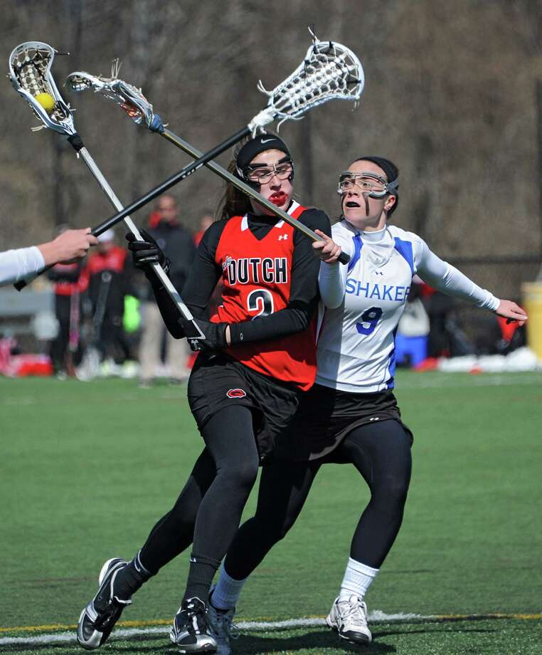Guilderland's Kaitlyn Becker, left, is defended by Shaker's Julia Lennon during a lacrosse game at Siena College on Wednesday, April 16, 2014 in Loudonville, N.Y. (Lori Van Buren / Times Union) Photo: Lori Van Buren / 00026482A