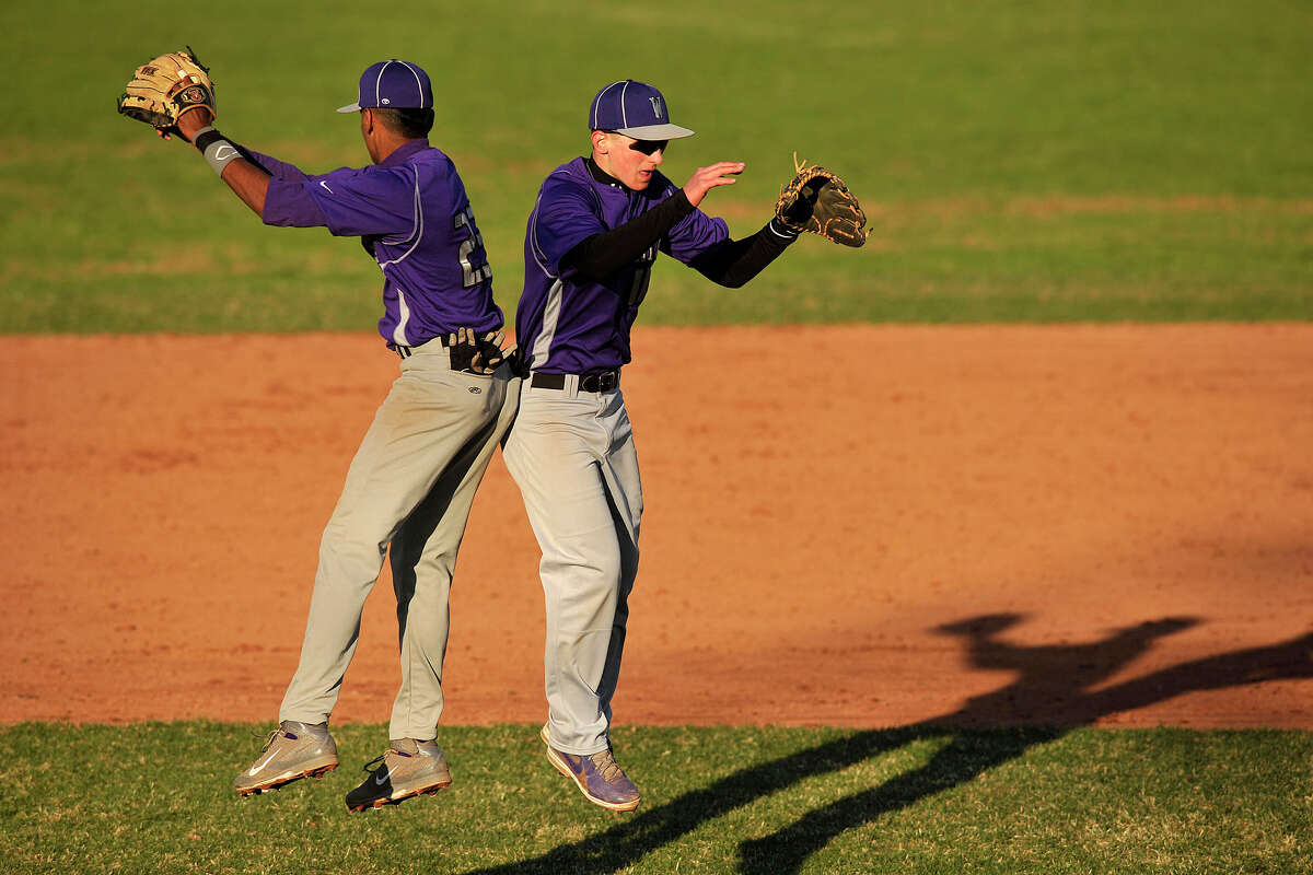 Westhill's Ronald Jackson, left, and John Spoto celebrate their 9-0 win over Wilton following their baseball game at Westhill High School in Stamford, Conn., on Wednesday, April 16, 2014.