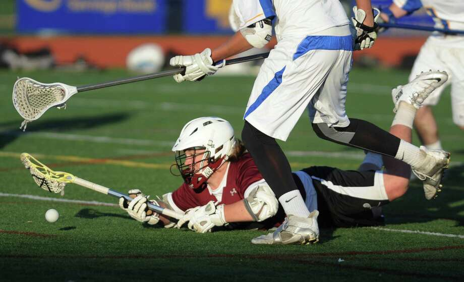 Bethel's Brad Haggarty reaches for the ball after falling to the ground in Brookfield's 15-7 win over Bethel in the high school boys lacrosse game at Brookfield High School in Brookfield, Conn. Wednesday, April 16, 2014. Photo: Tyler Sizemore / The News-Times