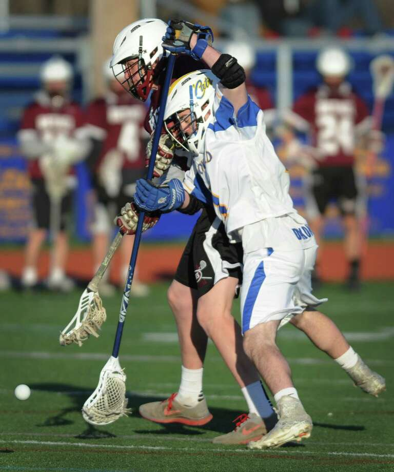 Bethel's Dylan Nyborg, left, and Brookfield's Daniel Dixon battle for the ball in Brookfield's 15-7 win over Bethel in the high school boys lacrosse game at Brookfield High School in Brookfield, Conn. Wednesday, April 16, 2014. Photo: Tyler Sizemore / The News-Times