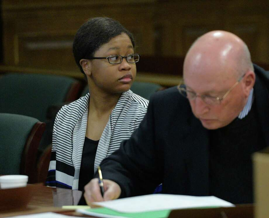 Trinity Copeland looks to the gallery Wednesday morning, April 16, 2014, during opening statements in her murder case at Rensselaer County Court  in Troy, N.Y.  Seated with Copeland is her defense attorney Michael Feit. (Skip Dickstein / Times Union) Photo: Skip Dickstein / 00026515A