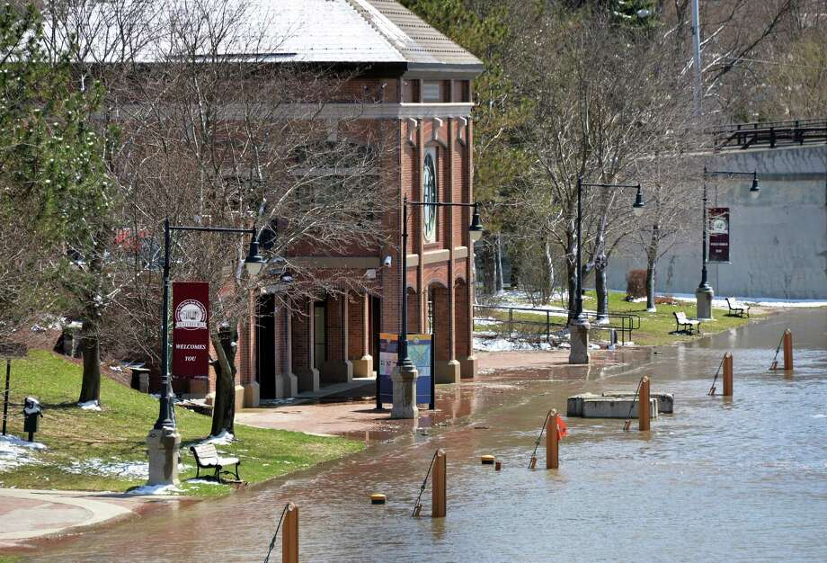 Floodwaters reach walkways at the Waterford Visitor's Center Wednesday, April 16, 2014, in Waterford, N.Y.  (John Carl D'Annibale / Times Union) Photo: John Carl D'Annibale / 00026519A