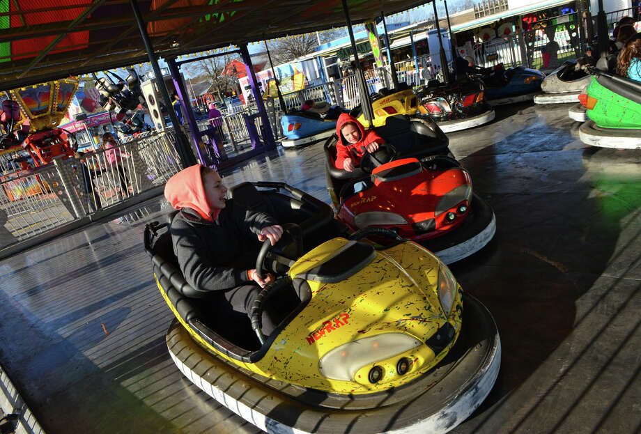 Kayla Crowe, 13, and her friend Bowen Redgate, 13, both of Trumbull, ride the bumper cars during the annual Trumbull Rotary Carnival at Hillcrest Middle School in Trumbull, Conn. on Wednesday April 16, 2014. The carnival runs through Saturday. Photo: Christian Abraham / Connecticut Post