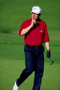 15 Feb 1995:   President of the Untied States Bill Clinton shushes to the gallery during the Bob Hope Chrysler Classsic in Palm Dessert, California. Mandatory Credit: J.D. Cuban  /Allsport Photo: J.D. Cuban, Getty Images / Getty Images North America