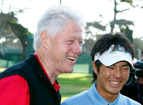 SAN FRANCISCO - OCTOBER 06:  Former U.S. President Bill Clinton poses with Ryo Ishikawa of the International Team during a practice round prior to the start of The Presidents Cup at Harding Park Golf Course on October 6, 2009 in San Francisco, California.  (Photo by Scott Halleran/Getty Images) *** Local Caption *** Bill Clinton;Ryo Ishikawa Photo: Scott Halleran, Getty Images / 2009 Getty Images