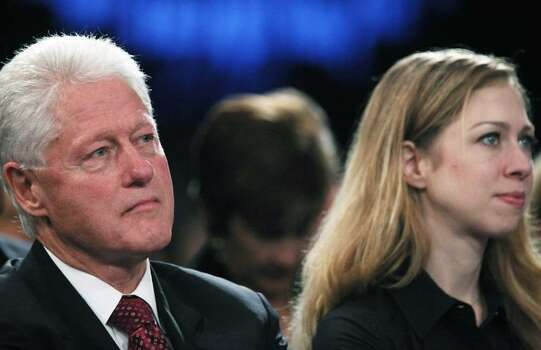 NEW YORK - SEPTEMBER 25:  Former President Bill Clinton (L) and Chelsea Clinton look on as U.S. Secretary of State Hillary Rodham Clinton speaks at the Clinton Global Initiative (CGI) September 25, 2009 in New York City. The fifth annual meeting of the CGI gathers prominent individuals in politics, business, science, academics, religion and entertainment to discuss global issues such as climate change and peace in the Middle East. The event, founded by Clinton after he left office, is held the same week as the General Assembly at the United Nations, when most world leaders are in New York City.  (Photo by Mario Tama/Getty Images) Photo: Mario Tama, Getty Images / 2009 Getty Images