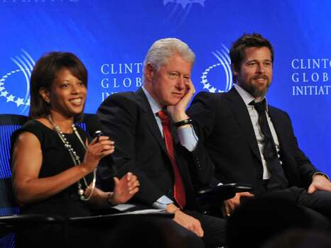 NEW YORK - SEPTEMBER 24:  Melody Barnes, Director of Domestic Policy Council, White House, Bill Clinton, 42nd President, United States of America and Brad Pitt, Founder of Make it Right attends the 2009 Clinton Global Initiative Special Session: Building A Better Future - A Progress Report on Making it Right in New Orleans at the Sheraton New York Hotel & Towers on September 24, 2009 in New York City.  (Photo by Bobby Bank/Getty Images) *** Local Caption *** Melody Barnes;Bill Clinton;Brad Pitt Photo: Bobby Bank, Getty Images / 2009 Getty Images