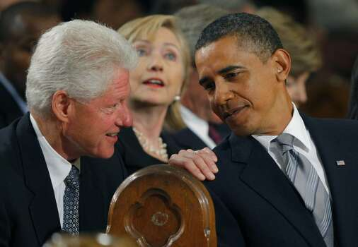 BOSTON - AUGUST 29:  Former President Bill Clinton (L) talks with President Barack Obama (R) as Secretary of State Hillary Clinton (C) looks on during funeral services for U.S. Senator Edward Kennedy at the Basilica of Our Lady of Perpetual Help August 29, 2009 in Boston, Massachusetts. Kennedy, youngest sibling to brothers President John F. Kennedy and Robert F. Kennedy, died of brain cancer August 25.  (Photo by Brian Snyder-Pool/Getty Images) *** Local Caption *** Hillary Clinton;Barack Obama;Bill Clinton Photo: Pool, Getty Images / 2009 Getty Images