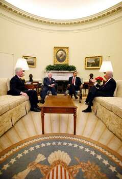 WASHINGTON - APRIL 21:  (AFP OUT)  U.S. President Barack Obama (2R) meets in the Oval Office with former President Bill Clinton (L), Sen. Ted Kennedy (D-MA) (2L), and Vice President Joe Biden (R) prior to a bill signing event for the Edward M. Kennedy Serve America Act in the White House April 21, 2009 in Washington, DC. The bill intends to more than triple the AmeriCorp volunteers to over 250,000 in the United States costing taxpayers roughly a billion dollars a year, over the next five years.  (Photo by Martin H. Simon-Pool/Getty Images) *** Local Caption *** Joe Biden;Ted Kennedy;Bill Clinton;Barack Obama Photo: Pool, Getty Images / 2009 Getty Images
