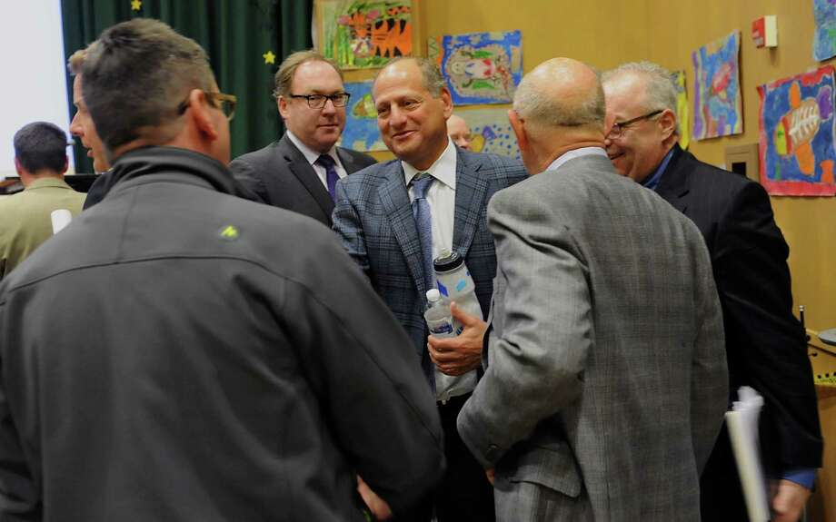 Developer David Flaum, center, greets people after a public forum about the casino plans for Albany at Giffen Memorial Elementary School on Wednesday, April 16, 2014 in Albany, N.Y. (Lori Van Buren / Times Union) Photo: Lori Van Buren / 00026497A