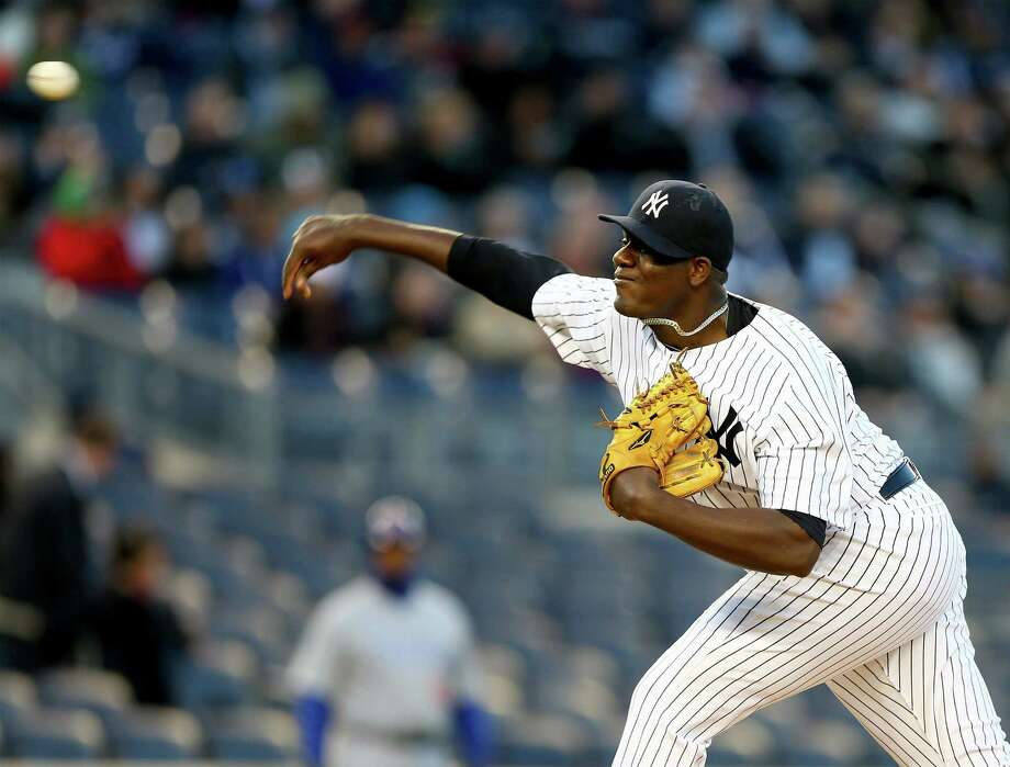 NEW YORK, NY - APRIL 16:  Michael Pineda #35 of the New York Yankees delivers a pitch in the first inning against the Chicago Cubs during game two of a doubleheader on April 16, 2014 at Yankee Stadium in the Bronx borough of New York City.  (Photo by Elsa/Getty Images) ORG XMIT: 477580121 Photo: Elsa / 2014 Getty Images