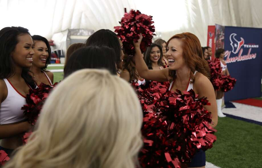 Sarah C. hugs other newly announced Texans Cheerleaders. Fifty girls showed up on April 16, 2014 at the Houston Texans practice facility in Houston, Texas to see which 35 girls made the 2014-2015, Houston Texans Cheerleading Team. Photo: Thomas B. Shea
