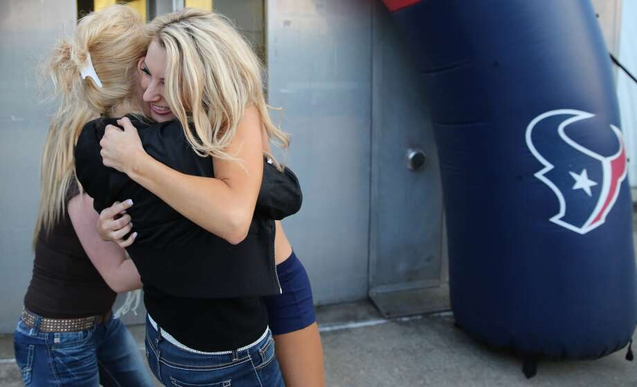 Brittany M. hugs her mother Kathy Perrish and her step sister Brittany Perrish after they found out she made the squad. This was Brittany fourth year trying out for the team. Fifty girls showed up on April 16, 2014 at the Houston Texans practice facility in Houston, Texas to see which 35 girls made the 2014-2015, Houston Texans Cheerleading Team. Photo: Thomas B. Shea