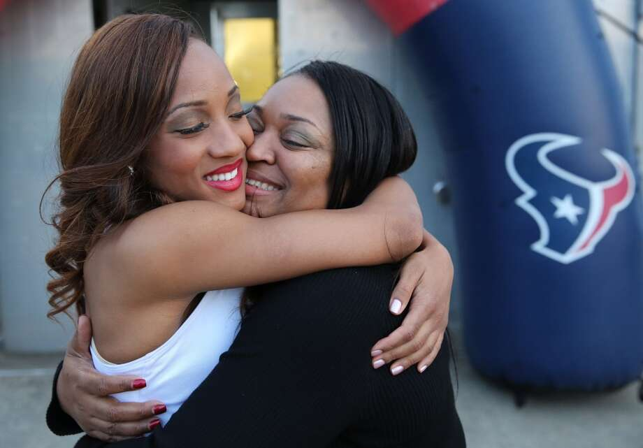 New Houston Texans cheerleader Daranesha hugs her mother Richie Herron after finding out she made the team. Fifty girls showed up on April 16, 2014 at the Houston Texans practice facility in Houston, Texas to see which 35 girls made the 2014-2015, Houston Texans Cheerleading Team. Photo: Thomas B. Shea