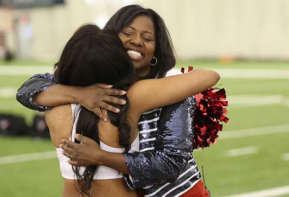 Houston Texans Cheerleader Director Alto Gray hugs a new cheerleader. Fifty girls showed up on April 16, 2014 at the Houston Texans practice facility in Houston, Texas to see which 35 girls made the 2014-2015, Houston Texans Cheerleading Team. Photo: Thomas B. Shea