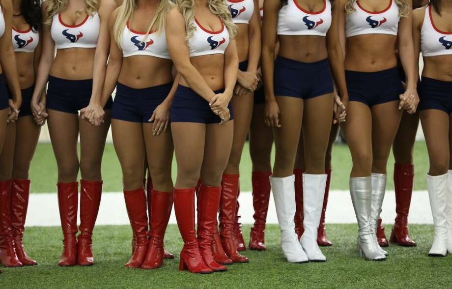 Girls wait nervously and hold each others hands while waiting to hear their names being called out. Fifty girls showed up on April 16, 2014 at the Houston Texans practice facility in Houston, Texas to see which 35 girls made the 2014-2015, Houston Texans Cheerleading Team. Photo: Thomas B. Shea
