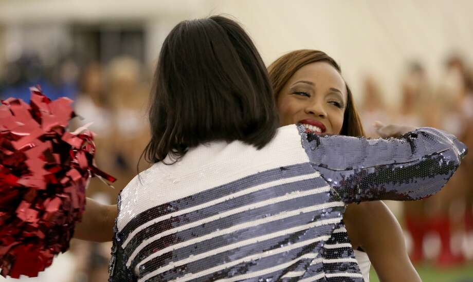 Houston Texans Cheerleader Director Alto Gray hugs Daranesha H. after making the team. Fifty girls showed up on April 16, 2014 at the Houston Texans practice facility in Houston, Texas to see which 35 girls made the 2014-2015, Houston Texans Cheerleading Team. Photo: Thomas B. Shea