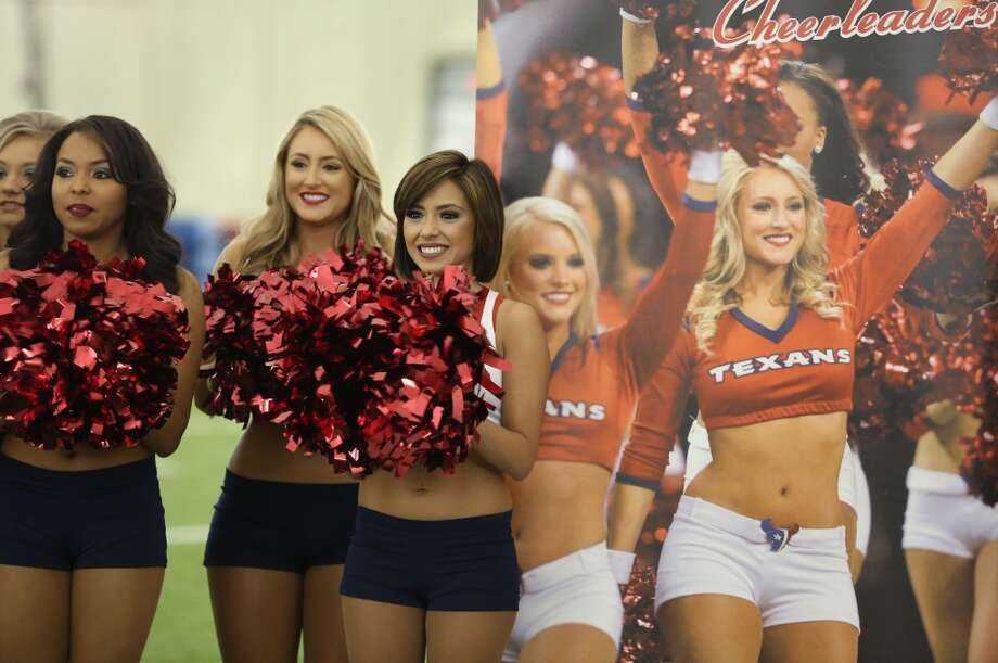 Newly announced cheerleaders smile as another name is called. Fifty girls showed up on April 16, 2014 at the Houston Texans practice facility in Houston, Texas to see which 35 girls made the 2014-2015, Houston Texans Cheerleading Team. Photo: Thomas B. Shea