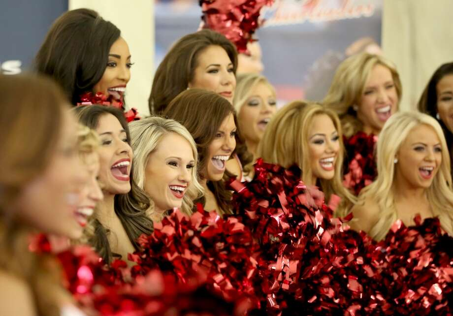 The Houston Texans Cheerleading team poses for pictures and TV interviews. Fifty girls showed up on April 16, 2014 at the Houston Texans practice facility in Houston, Texas to see which 35 girls made the 2014-2015, Houston Texans Cheerleading Team. Photo: Thomas B. Shea