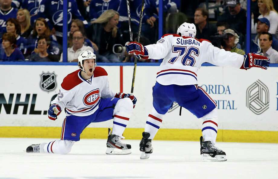 TAMPA, FL - APRIL 16:  Dale Weise #22 of the Montreal Canadiens celebrates his game-winning goal in overtime with P.K. Subban #76 against the Tampa Bay Lightning in Game One of the First Round of the 2014 Stanley Cup Playoffs at the Tampa Bay Times Forum on April 16, 2014 in Tampa, Florida. (Photo by Mike Carlson/Getty Images) ORG XMIT: 485350957 Photo: Mike Carlson / 2014 Getty Images