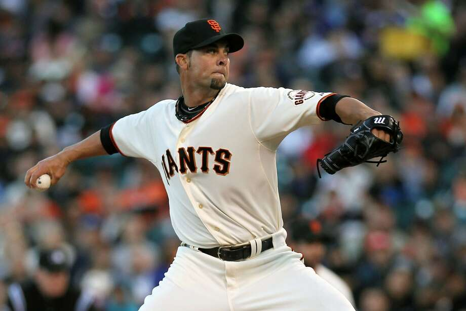 Apr 16, 2014; San Francisco, CA, USA;  San Francisco Giants starting pitcher Ryan Vogelsong (32) throws to the Los Angeles Dodgers in the first inning of their baseball game at AT&T Park. Mandatory Credit: Lance Iversen-USA TODAY Sports Photo: Lance Iversen, Reuters