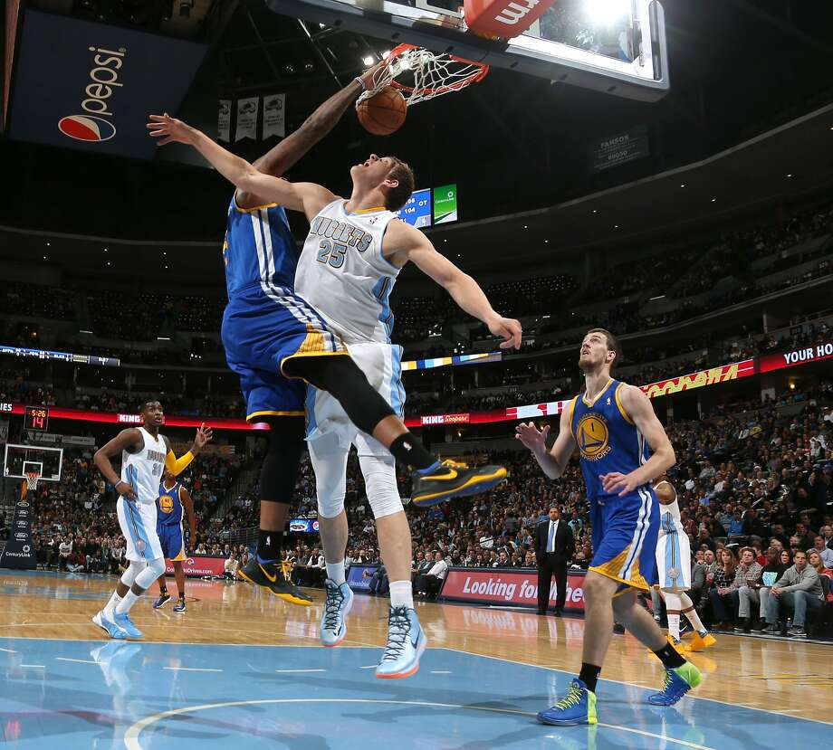Warriors center Marreese Speights, who had 11 points and six rebounds, dunks over Timofey Mozgov as Golden State ended the regular season with a win. Photo: David Zalubowski, Associated Press