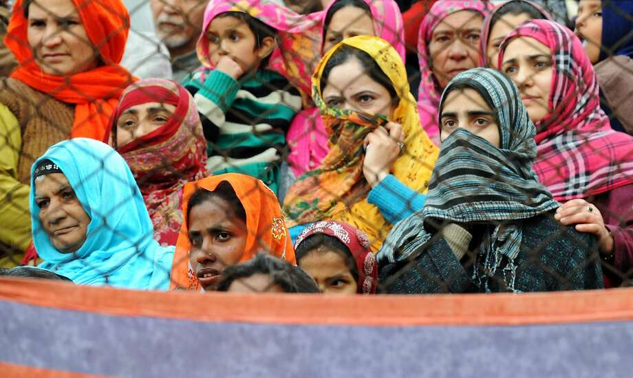 Indian supporters of union minister, patron for the National Conference and candidate for Srinagar's seat for the lower house of parliament in India's general election Farooq Abdullah (unseen) listen as he speaks during an election rally in Srinagar on April 16, 2014. Indians began voting April 7 in the world's biggest election, which is set to sweep the Hindu nationalist opposition to power at a time of low growth, anger over corruption and warnings about religious unrest. Elections are being held in nine phases from April 7 until May 12.  TOPSHOTS/AFP PHOTO / Rouf BHATROUF BHAT/AFP/Getty Images Photo: Rouf Bhat, AFP/Getty Images
