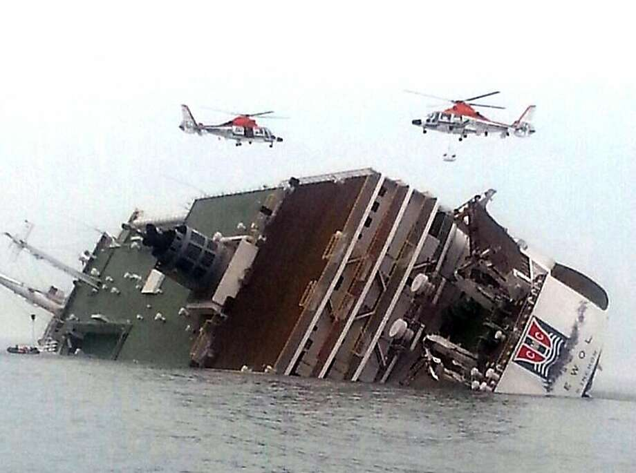 Rescue helicopters fly over a sinking South Korean passenger ferry that was carrying more than 450 passengers, mostly high school students, Wednesday, April 16, 2014, off South Korea's southern coast. Hundreds of people are missing despite a frantic, hours-long rescue by dozens of ships and helicopters. At least four people were confirmed dead and 55 injured. (AP Photo/Yonhap) KOREA OUT Photo: Uncredited, Associated Press