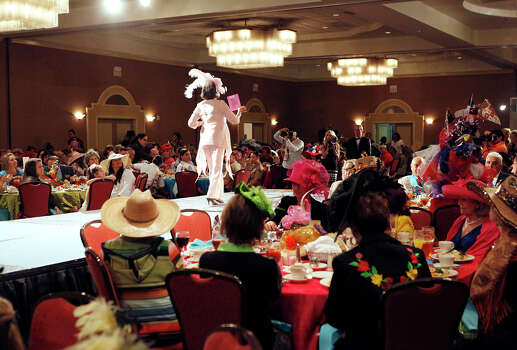 Graciela Carrillo walks the runway during The Woman's Club of San Antonio's Fiesta Hat Contest, Luncheon and Fashion Show April 16, 2014 at the Omni San Antonio Hotel at the Colonnade. Photo: Cynthia Esparza, For The San Antonio Express-News / For the San Antonio Express-News