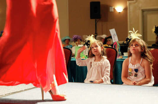 Greer Kemmett (right) and Macie Urban, watch as media personalities walk the runway during The Woman's Club of San Antonio Fiesta Hat Contest, Luncheon and Fashion Show April 16, 2014 at the Omni San Antonio Hotel at the Colonnade. Photo: Cynthia Esparza, For The San Antonio Express-News / For the San Antonio Express-News